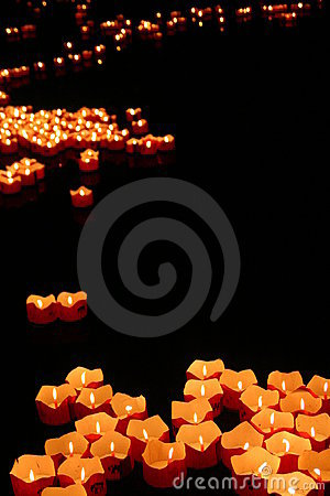 Red candles on the vagrant waters.