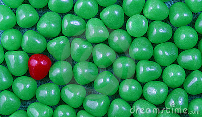 Red candy in green background