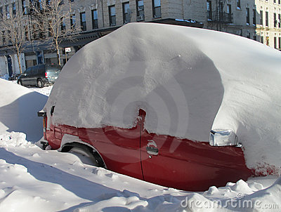 Red car buried in snow after blizzard  Editorial Photo