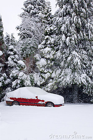 Red car covered in snow