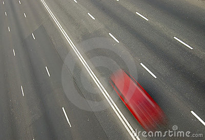Red car with motion blur