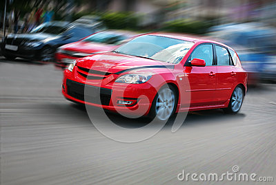 Red car in movement