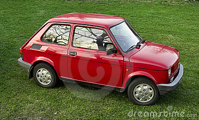 Red car parked on grass