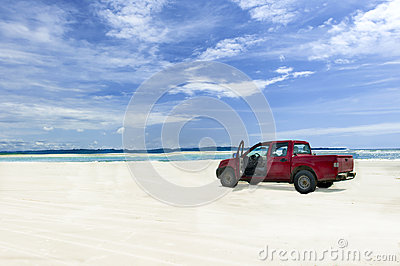 Car on a tropical beach