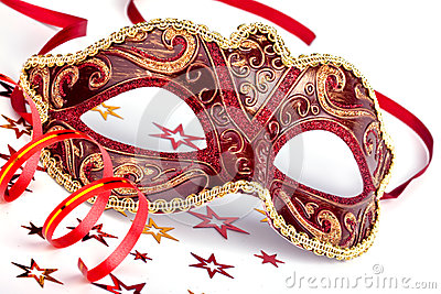 Red carnival mask with confetti and streamer