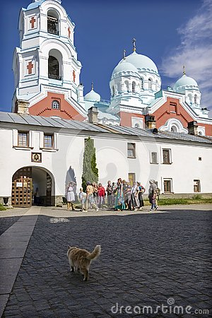 Free Red Cat Goes To Meet A Group Of Tourists Who Want To Get To The Transfiguration Valaam Monastery. Stock Images - 149718644