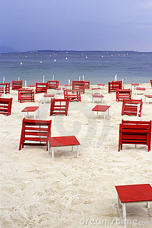 Red chairs on a empty beach