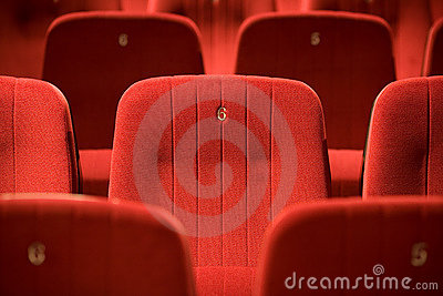 Red chairs on the empty cinema