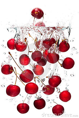 Red cherries falling in water