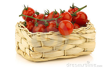 Red cherry tomatoes in a woven basket
