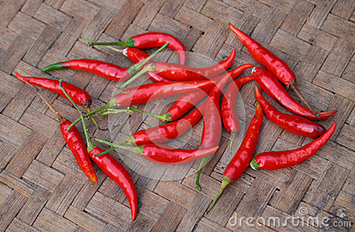 Red chili peppers on bamboo weave background