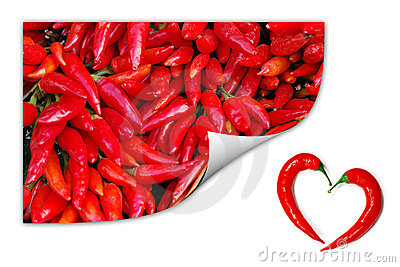 Red chili peppers with two peppers forming a heart