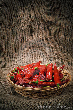 Red chili peppers on the wicker dish