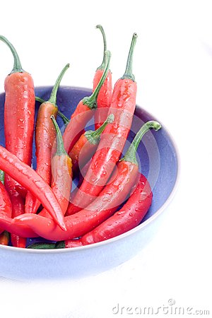 Red chillis in blue bowl