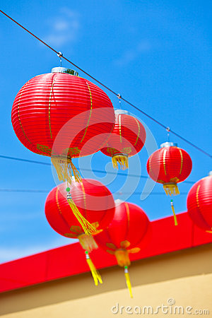 Red Chinese Paper Lanterns against a Blue Sky