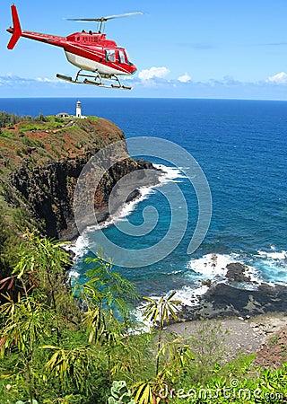 Red chopper above bay