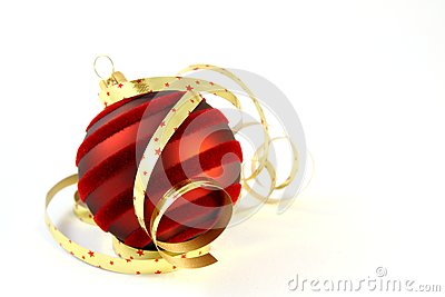 Red Christmas ball with curly ribbons on white