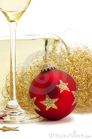 Red christmas ball near glass with champagne, ange