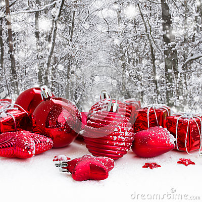Red christmas balls in snowed forest