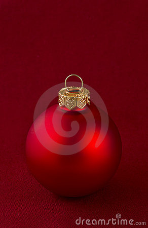 Red christmas bauble on red