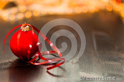 Red Christmas Bauble With Red Ribbon On Wooden Surface In Close Up Photography Free Public Domain Cc0 Image