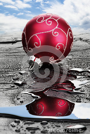 Red Christmas Bauble on Wet Slate