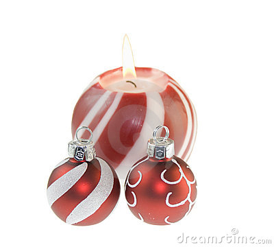Red Christmas candle with baubles