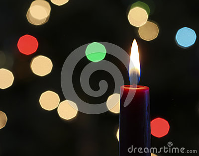 A Red Christmas Candle with Blurred Lights