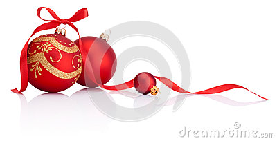 Red christmas decoration balls with ribbon bow  on white