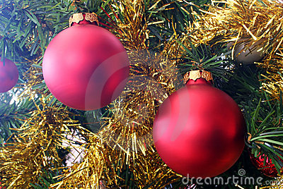 Red Christmas Decorations And Gold Tinsel