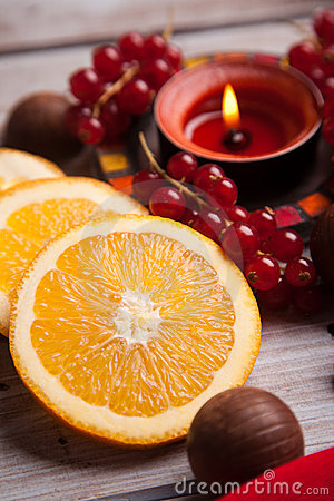 Red Christmas festive candles with orange