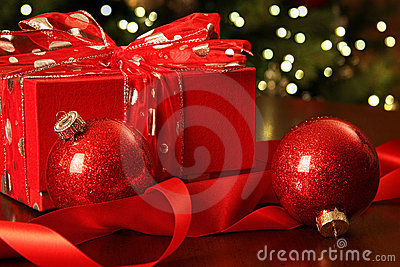 Red Christmas gift with ornaments