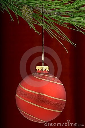 Red Christmas ornament on a burgundy background