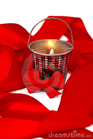 Red christmas ribbon  and candle