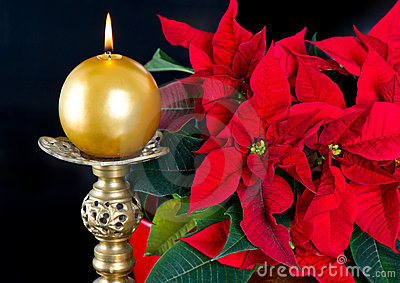 Red christmas star with golden candle