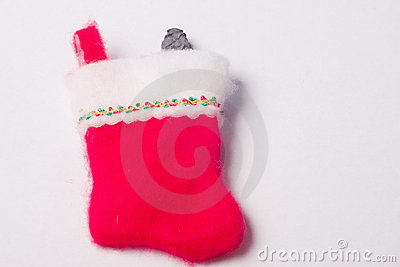 Red Christmas stocking with Lump of coal sticking