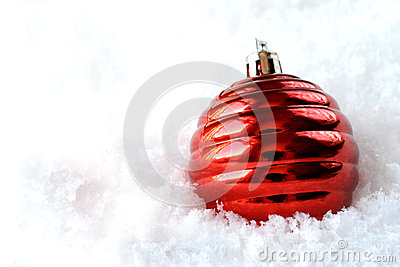 Red Christmas tree decoration in snow