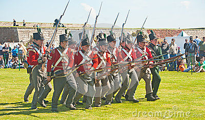 Red coat soldiers making a charge at Fort George Editorial Stock Photo