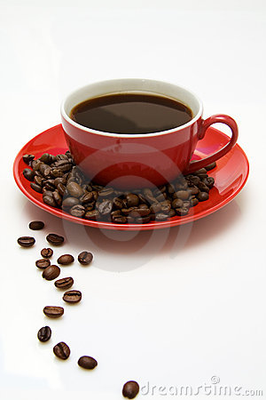 Red coffee cup and beans.