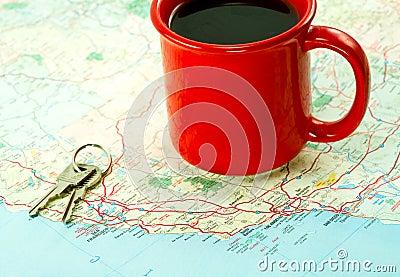 Red Coffee Mug and Car Keys on Map