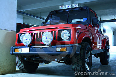 Red Color Jeep with Fog Lights