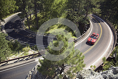 Red convertible driving on Iron Mountain Editorial Photo