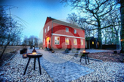 A red cottage at sunset Editorial Stock Photo