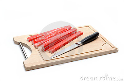 Red crab stick on wooden board.