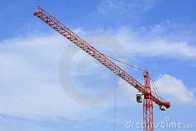 Red crane against blue sky