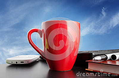 Red cup on a background of blue sky