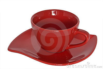 Red cup and saucer. Close-up.
