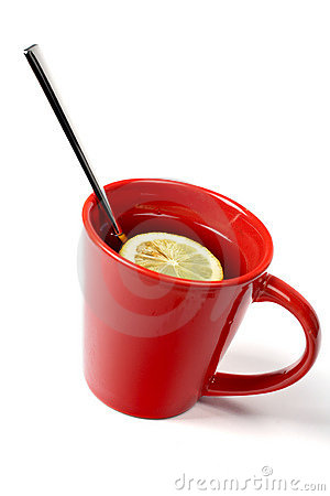 Red cup of tea with lemon and