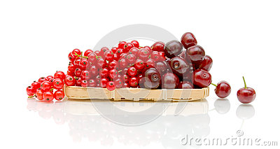 Red currant and ripe cherry on a white background