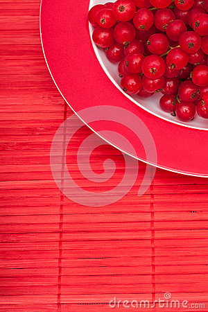 Red currants berries on a tablecloth